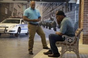 In this Wednesday, Sept. 2, 2015 photo, Officer Lamont Edwards talks to actor Nathan Purdee during a Crisis Intervention Training class at the New York Police Department Police Academy, in New York. A new training for New York City police is combining actors, the mentally ill and psychology experts to better prepare officers responding to people in the throes of a mental crisis. (AP Photo/Mary Altaffer)